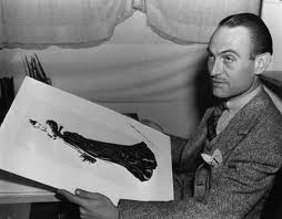 GWTW costume designer Walter Plunkett with one of his designs