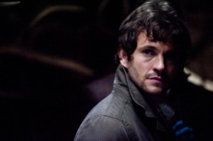 Will Graham rocking this winter's essential turned up collar at a crime scene.