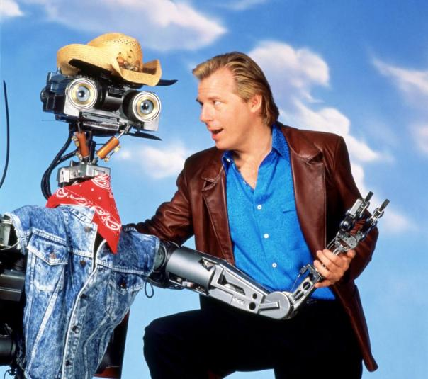 SHORT CIRCUIT 2, from left: Johnny Five, Michael McKean, 1988, ©TriStar Pictures